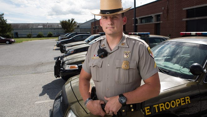 Trooper First Class B. Pollmeier poses for a photo at the Maryland State Police Barack E on Monday, Sept. 12, 2016.  Pollemeier helped canvas high crime areas in an effort to combat the heroin epidemic in Wicomico County.