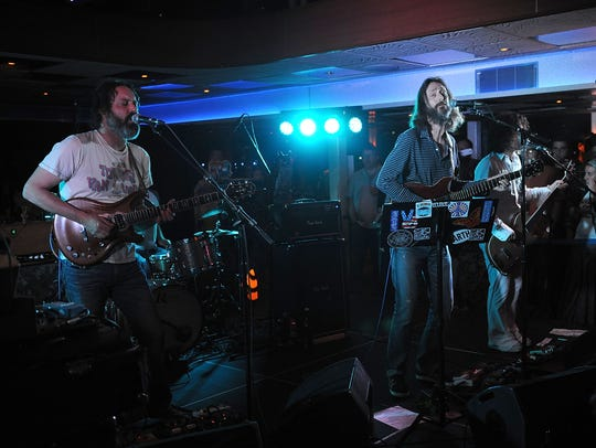 Guitarist Neal Casal, left, with the Chris Robinson