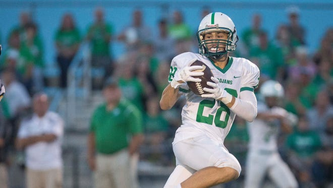 New Castle's Luke Bumbalough, shown here against Delta earlier this season, set the state record for touchdown catches in a season with 27.