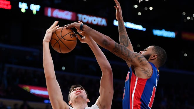 Lakers center Ivica Zubac, left, has his shot blocked by Pistons forward Marcus Morris during the second half of the Pistons' 102-97 win Sunday in Los Angeles.