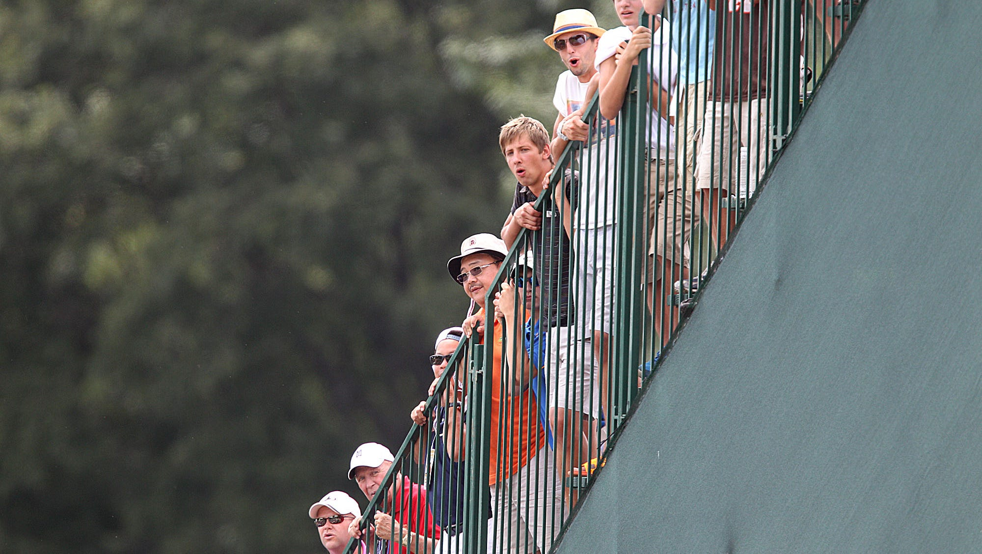 Fans watch off the grandstands on 18 Sunday.