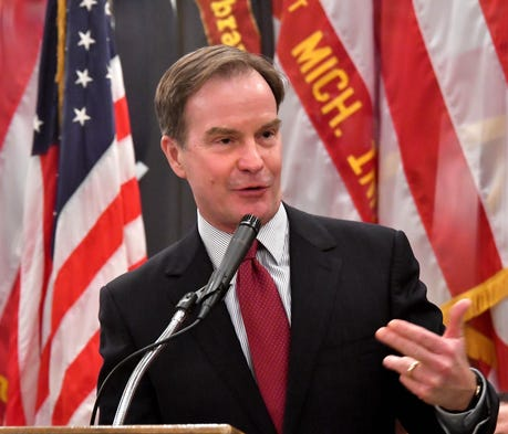 GOP Attorney General Bill Schuette and his wife ea...