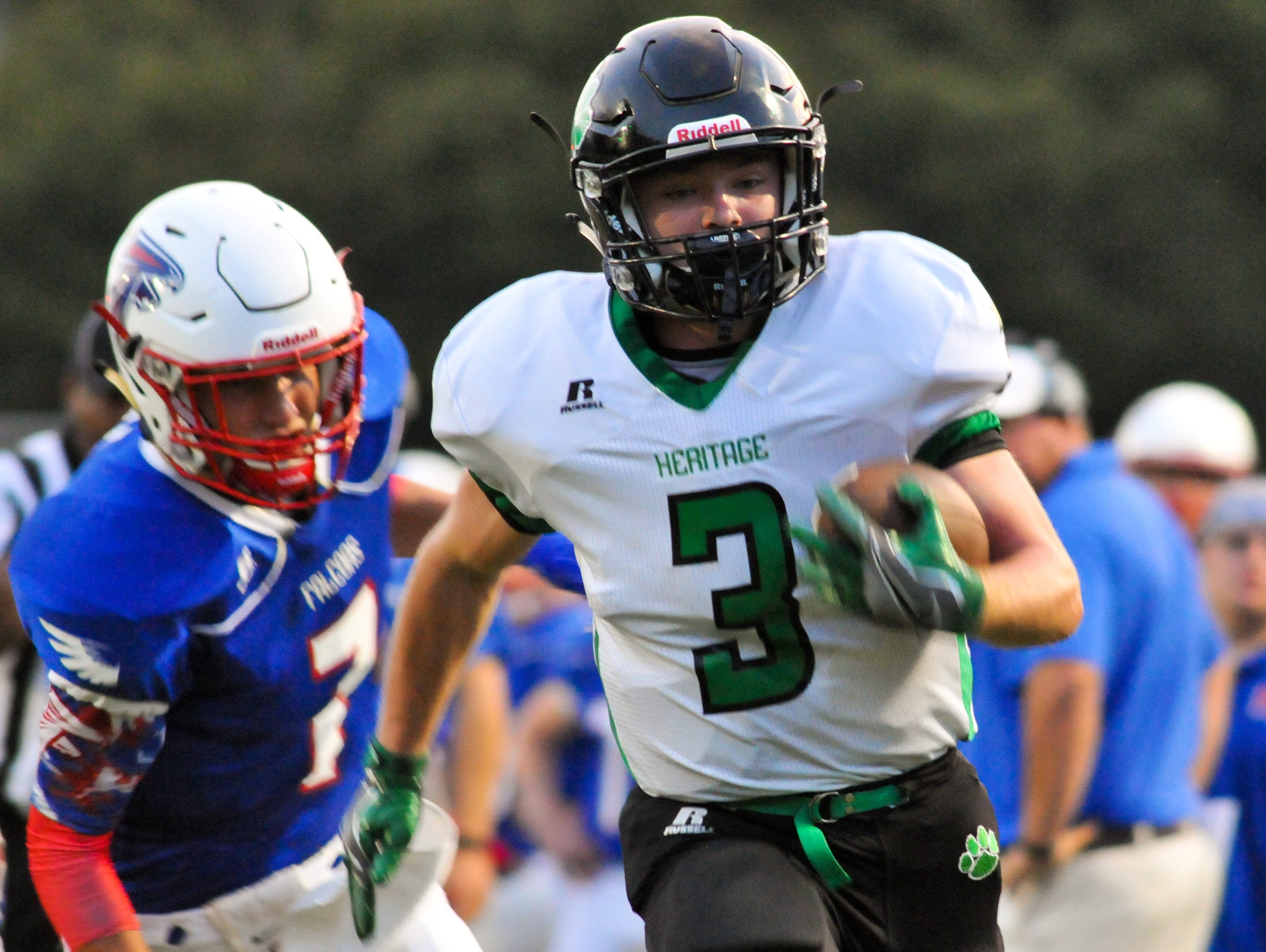 Junior Denton (3) carries the ball for Mountain Heritage in Friday's win at West Henderson.