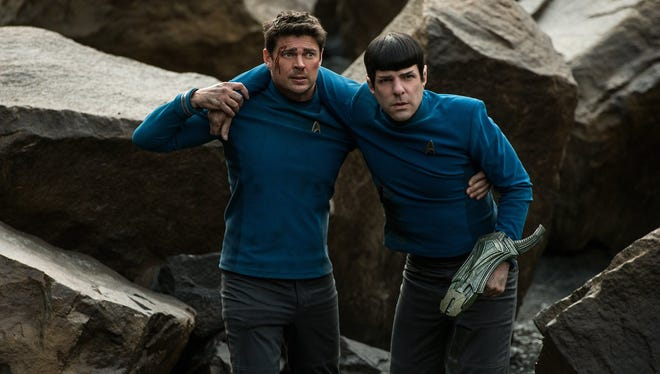 "McCoy (Karl Urban) and Spock (Zachary Quinto) are back again in ""Star Trek Beyond."""
