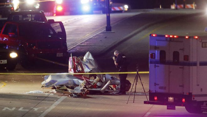 Emergency vehicles at the scene of a mid-air collision Saturday night near McKinney, Texas.
