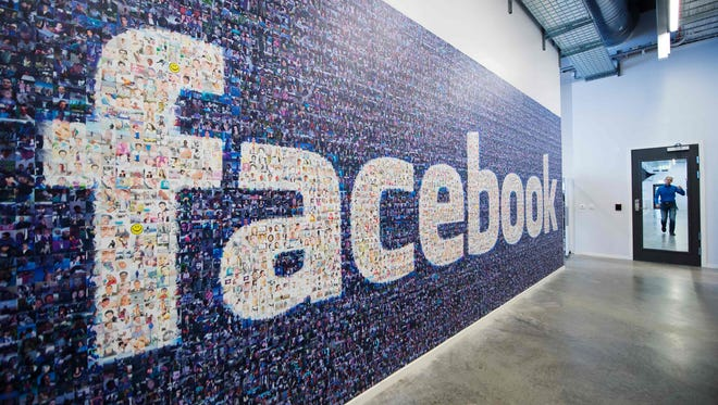 A logo created from pictures of Facebook users worldwide is pictured in the company's Data Center, its first outside the US in Lulea, in Swedish Lapland in November 2013.
