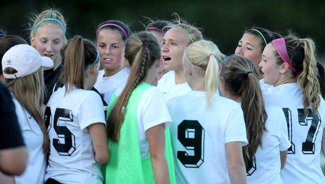 Klahowya senior Hailey Sargent (center) talks to teammates during last week's home game against Port Townsend. Sargent, who had open heart surgery at age 8, started as a freshman on Klahowya's state-title winning team in 2014.