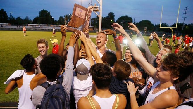 The Harrison Raiders celebrate winning the boys track sectional Tuesday, May 15, 2018, at Gordon Straley Field in West Lafayette. Without winning a single event, Harrison won the team title with 141.5 points. West Lafayette finished second at 124 points. It was the first sectional title for Harrison since 2004.