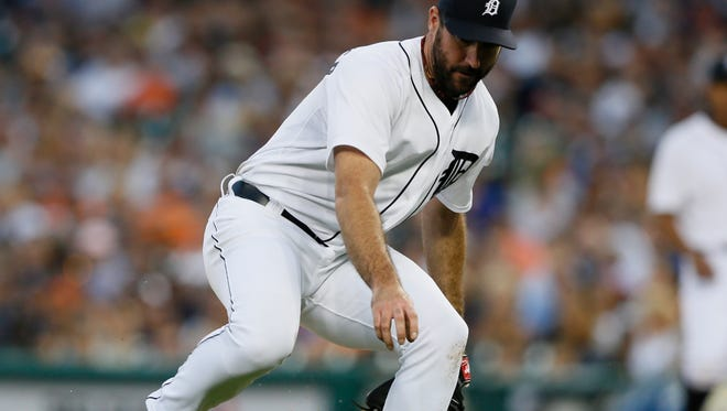 Tigers pitcher Justin Verlander chases down a ball that hit off his glove and went for an infield single for Royals DH Kendrys Morales in the sixth inning of the Royals' 5-1 win on Tuesday.
