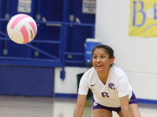 Kirtland Central's Shania John digs out a ball against Bloomfield on Tuesday at Bobcat Gym in Bloomfield.