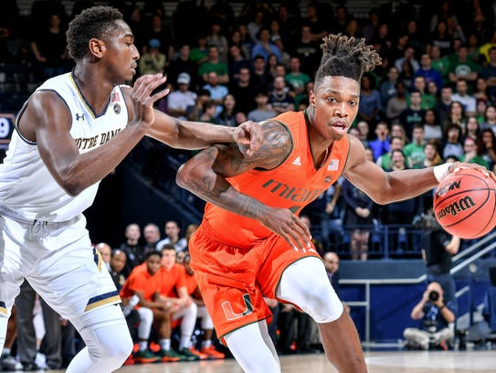 Miami Hurricanes guard Lonnie Walker IV (4) dribbles