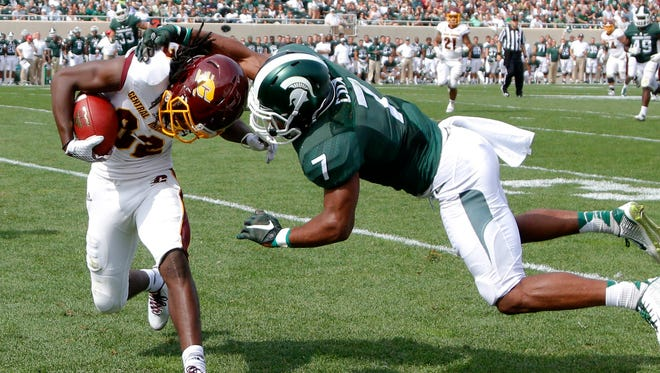 Central Michigan receiver Corey Willis, left, is forced out of bounds by Michigan State's Demetrious Cox (7) after a 27-yard reception during the second quarter of an NCAA college football game, Saturday, Sept. 26, 2015, in East Lansing.