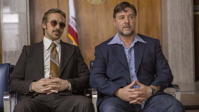 """Russel Crowe and Ryan Gosling in """"The Nice Guys.""""  The movie opens Thursday at Regal West Manchester Stadium 13, Frank Theatres Queensgate Stadium 13 and R/C Hanover Movies."""