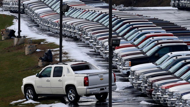 The popularity of pickups, like these Chevy trucks on a dealer lot in Murrysville, Pa., are raising the nation's average fuel economy level.