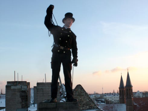 Chimney Sweep Timo Stahl Sweeps Out A Chimney On A Berlin