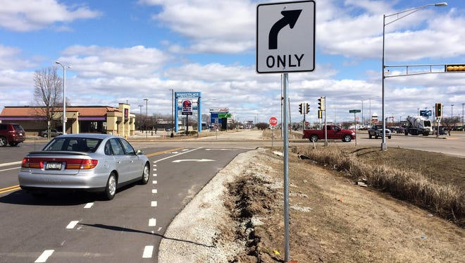The bike lanes on the newly constructed West College Avenue frontage road are restricted to right turns at Lilas Drive.