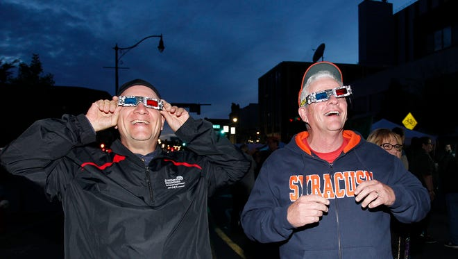 Jerry Serbonich, left, of Endicott and Mark Knoblauch of Newark Valley try out their 3D glasses during LUMA in downtown Binghamton on Friday night. September 1, 2017.