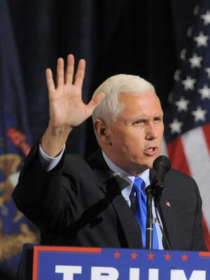 Republican vice presidential candidate Mike Pence speaks during the Macomb County Republican Party's Lincoln Day dinner at Palazzo Grande Banquet & Event Center in Shelby Township.