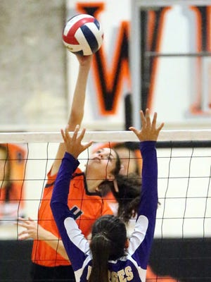 El Paso High's Emily Perez, 4, reaches up to get the ball over Alexa Leyva of Burges Tuesday night.