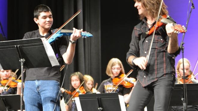 Mark Wood, right, artist-in-resident, performs with Oshkosh Area School District middle school students.