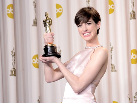 Anne Hathaway, winner of the Best Supporting Actress