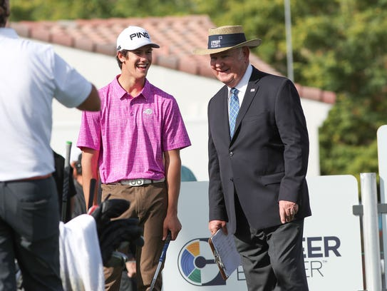 Palm Desert High School senior Charlie Reiter chats with the starter at the first hole at the La Quinta Country Club during the CareerBuilder Challenge, January 18, 2018.