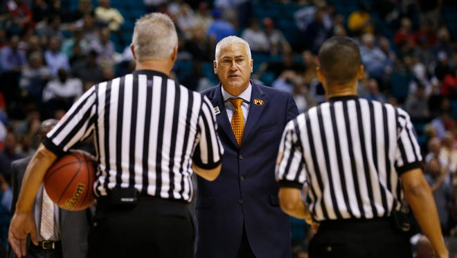 Oregon State head coach Wayne Tinkle speaks with officials in the first half of an NCAA college basketball game against Colorado in the first round of the Pac-12 conference tournament Wednesday, March 11, 2015, in Las Vegas.
