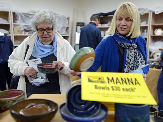 Alida Newton, left, and Fran Scott sort through hundreds of hand made ceramic bowls during the Pick a Bowl fundraiser for Manna Food Pantries on Friday night at Pensacola State College Anna Lamar Switzer Center for the Visual Arts. Attendees enjoyed music and food while raising money for Manna by bidding on silent auction items and purchasing hundreds of bowls. Another related fundraiser for Manna, Fill a Bowl for Manna, will be held on January 18, 2014 at the Jean & Paul Amos Performing Arts Center from 1-3p.m.