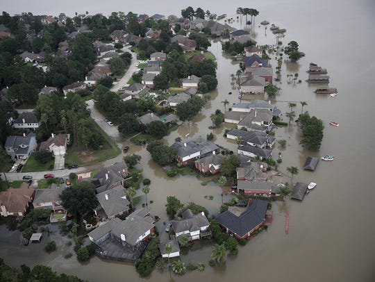 Flooded homes are shown near Lake Houston following