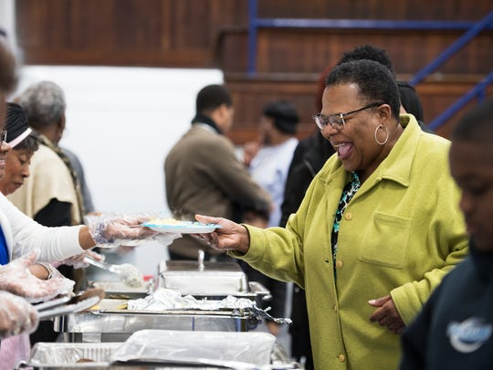 Janice Burch goes down the food line during the Dr. Martin Luther King Jr. breakfast at the Sterling Community Center on Monday, January 15, 2018.
