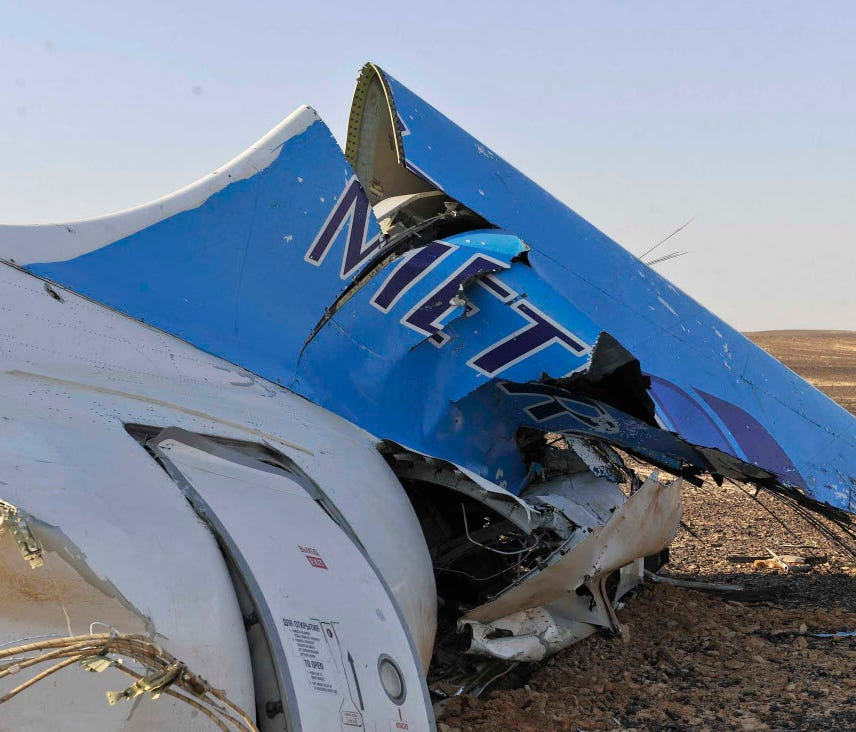 This photo released by the Egyptian prime minister's office shows the tail of a Russian Metrojet plane that crashed in Hassana, Egypt , killing 224 people aboard on Oct. 31, 2015, after an apparent bombing.
