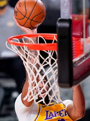 Los Angeles Lakers forward Anthony Davis scores against the Miami Heat during the first half in Game 4 of basketball's NBA Finals Tuesday, Oct. 6, 2020, in Lake Buena Vista, Fla. (AP Photo/Mark J. Terrill)