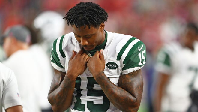 New York Jets wide receiver Brandon Marshall (15) reacts in the fourth quarter against the Arizona Cardinals at University of Phoenix Stadium.