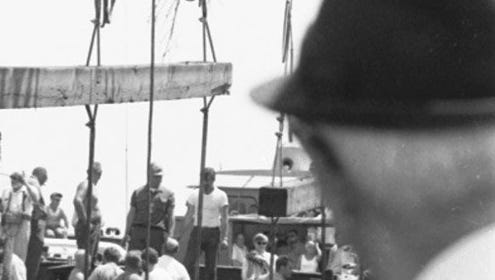 People in Marinette walk over the hull of the Alvin Clark in these July 30, 1969, file photos.  The Alvin Clark, dubbed the Mystery Ship, was built in 1846 and sunk in 1864 off Chambers Island in Michigan waters.  It was discovered by Frank Hoffman in 1967.  It took hiim two years to raise the ship and have it towed into the Marinette-Menominee harabor.  In 1981, the Coast Guard rated the Alvin Clark the oldest surviving documented merchant vessel of its kind.
