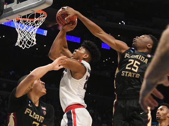 Gonzaga Bulldogs forward Rui Hachimura (21) shoots against Florida State Seminoles guard CJ Walker (2) and forward Mfiondu Kabengele (25) in the second half in the semifinals of the West regional of the 2018 NCAA Tournament at STAPLES Center.
