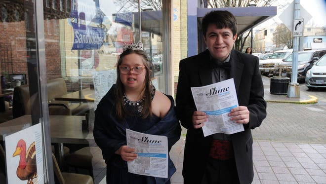 "Kimberly Taylor, 17, and Cody Davis show off their gown and tuxedo respectively as they prepare for the ""Night to Shine"" prom being held next Friday, Feb. 9 at Salem Alliance Church. The prom is for for people with special needs ages 14 and older."