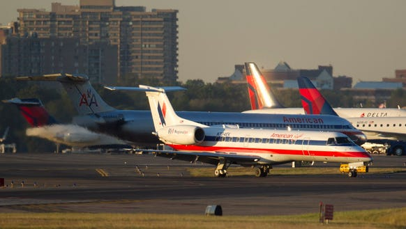 An American Eagle Embraer 135LR regional jet lands