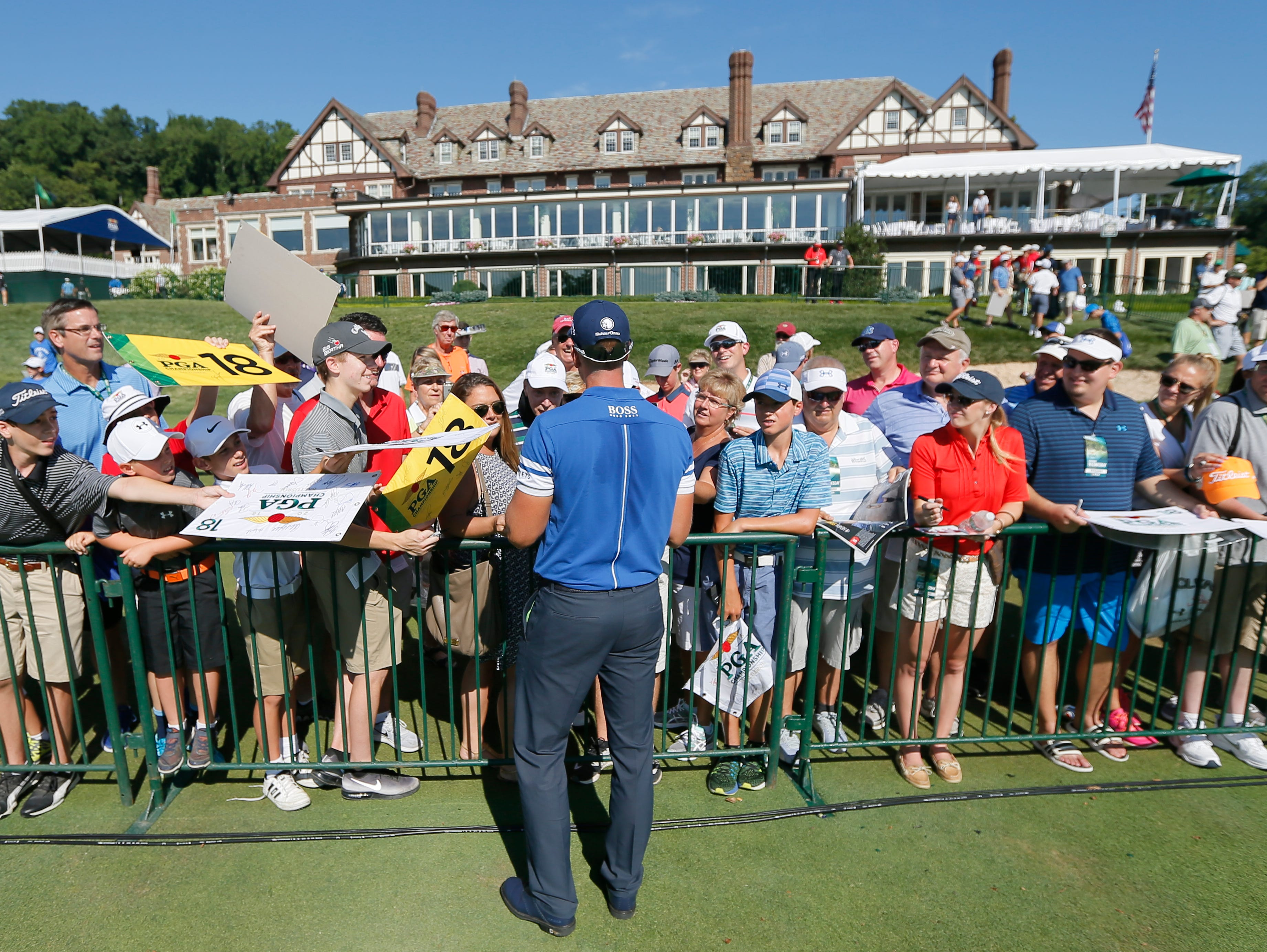 Henrik Stenson signs autographs on the 18th hole during a practice round for the PGA Championship golf tournament at Baltusrol Golf Club in Springfield, N.J.