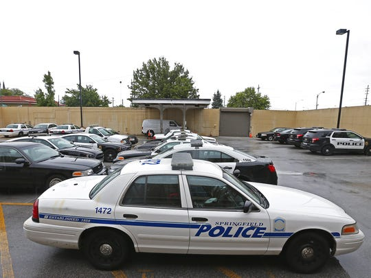 Springfield Police Department cruisers sit in the headquarters