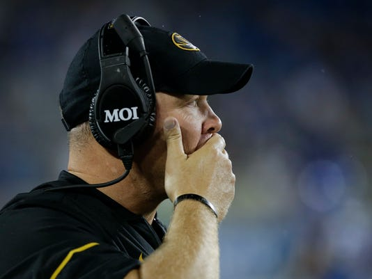 Missouri head coach Barry Odom watches his team line up for a play during the second half of an NCAA college football game against Kentucky, Saturday, Oct. 7, 2017, in Lexington, Ky. Kentucky won the game 40-34. (AP Photo/David Stephenson)