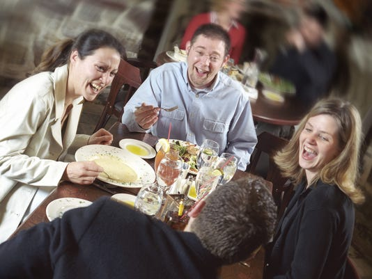 Friends Laughing Over Dinner