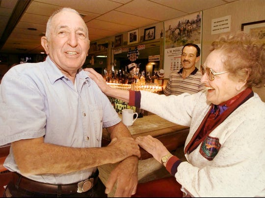 Bruno Selmi, called the patriarch of Gerlach, Nev., because he owned a lot of it including a bar and casino called Bruno's Country Club and the only motel in town, is patted, Wednesday, Nov. 12, 1997, by Lena Lucchesi, who lived in Gerlach for more than 60 years. Selmi came to visit her more than a half-century ago, asked Lena's husband for a job and never left. (