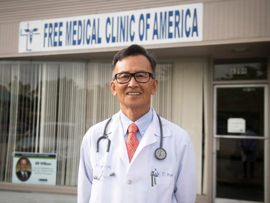 Dr. Tom Kim stands in front of the Free Medical Clinic