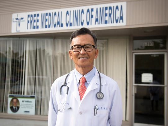 Dr. Tom Kim stands in front of the Free Medical Clinic of America on Thursday, May 31, 2018. Dr. Kim opened the clinic 25 years ago to serve the working poor.