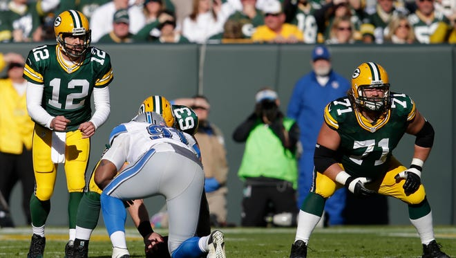Green Bay Packers' Josh Sitton blocks for Aaron Rodgers.The Green Bay Packers host the Detroit Lions Sunday, November 15, 2015, at Lambeau Field in Green Bay, Wis. Dan Powers/P-C Media