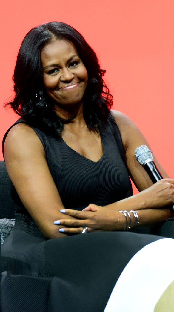 Former first lady Michelle Obama smiles during the