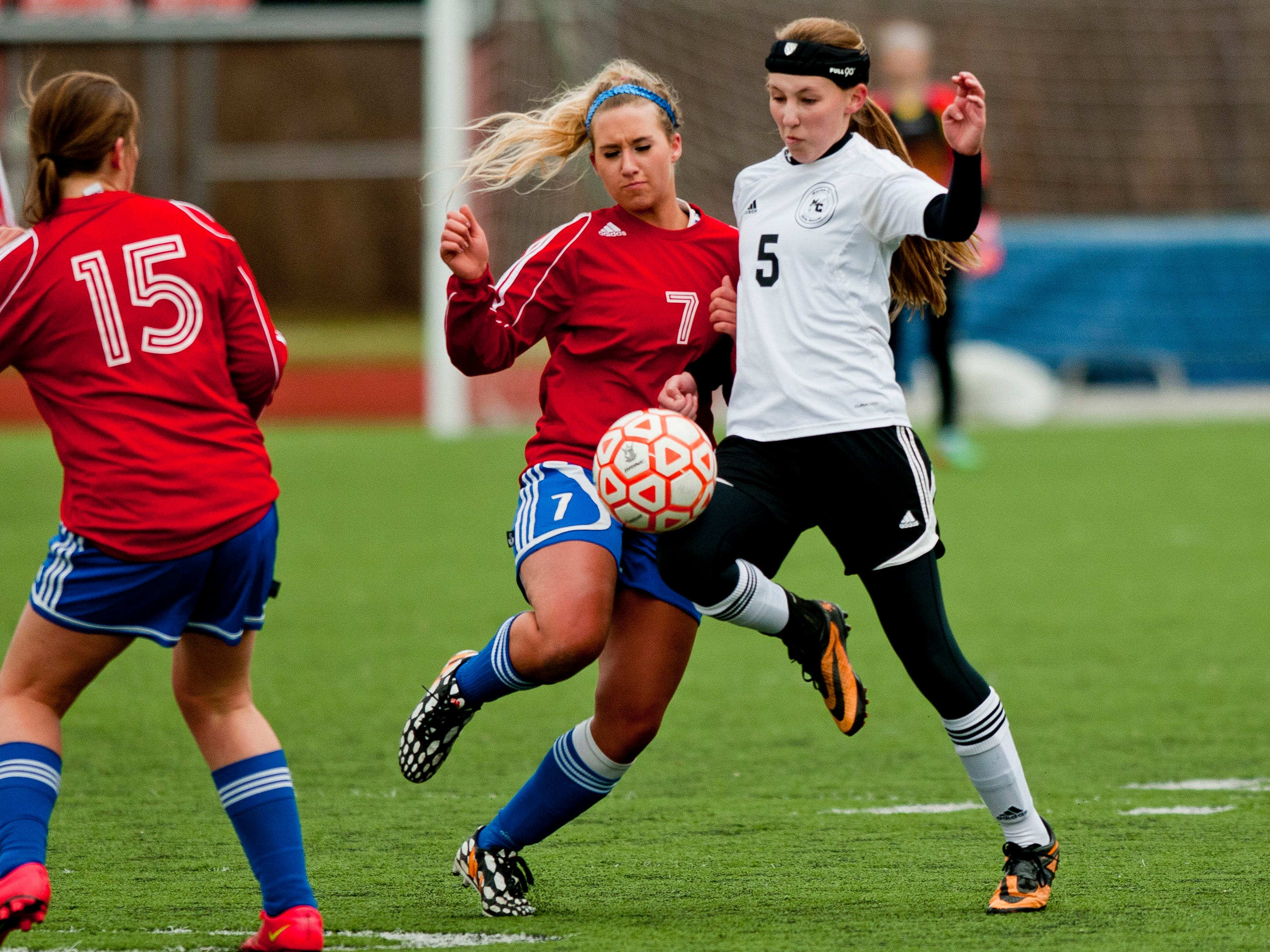 St. Clair's Laura Bluhm and Marine City's Emilie Andrews fight for possession during a soccer game Wednesday at East China Stadium.
