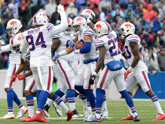 Buffalo Bills players celebrate after strong safety