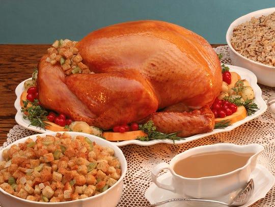 A Thanksgiving spread featuring turkey, stuffing, casserole