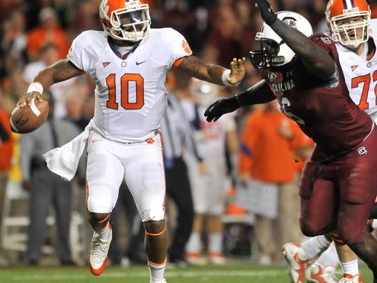 Clemson quarterback Tajh Boyd (10) fights off pressure